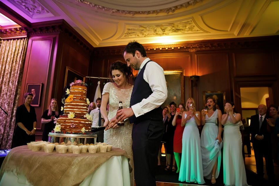 Natural cake cutting photography at Cowdray House in Sussex
